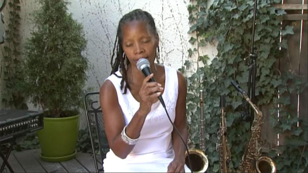 annual fun in the sun, sabrina sitting singing on stage7