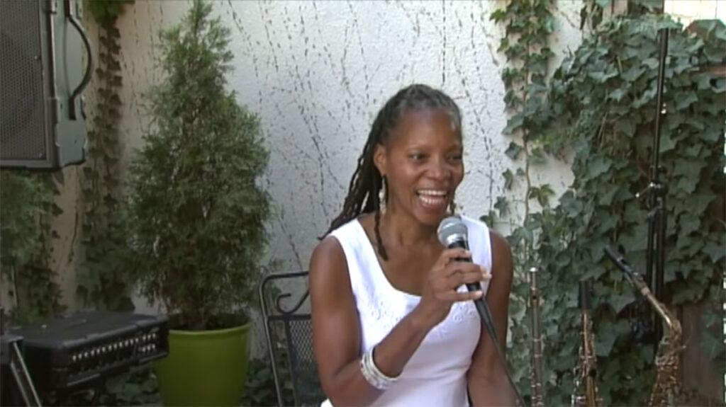 annual fun in the sun, sabrina sitting singing on stage1