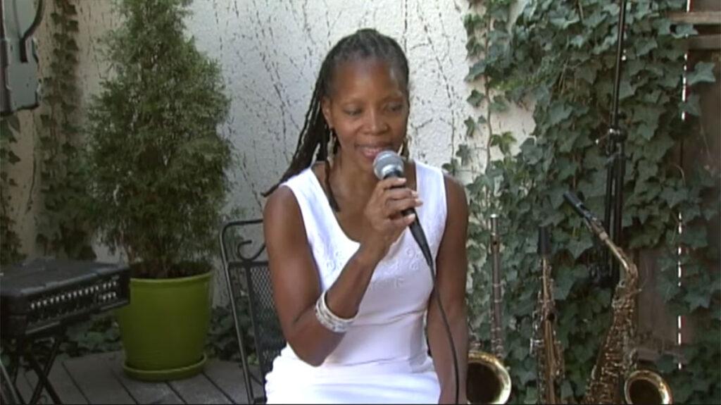 annual fun in the sun, sabrina sitting singing on stage4