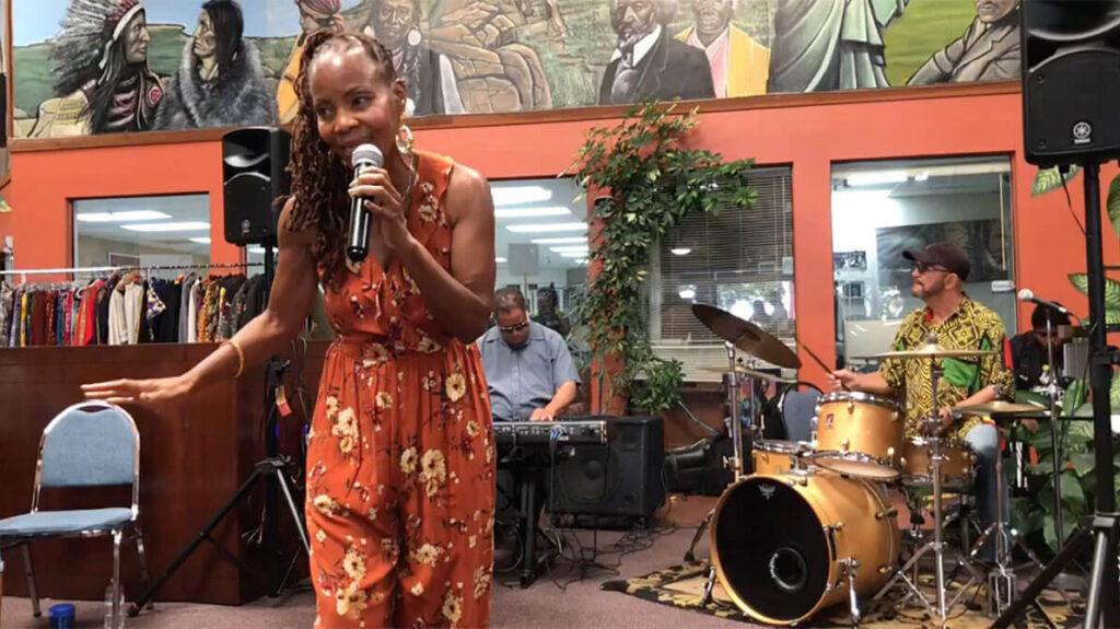 african marketplace 2019 - sabrina singing closeup 4