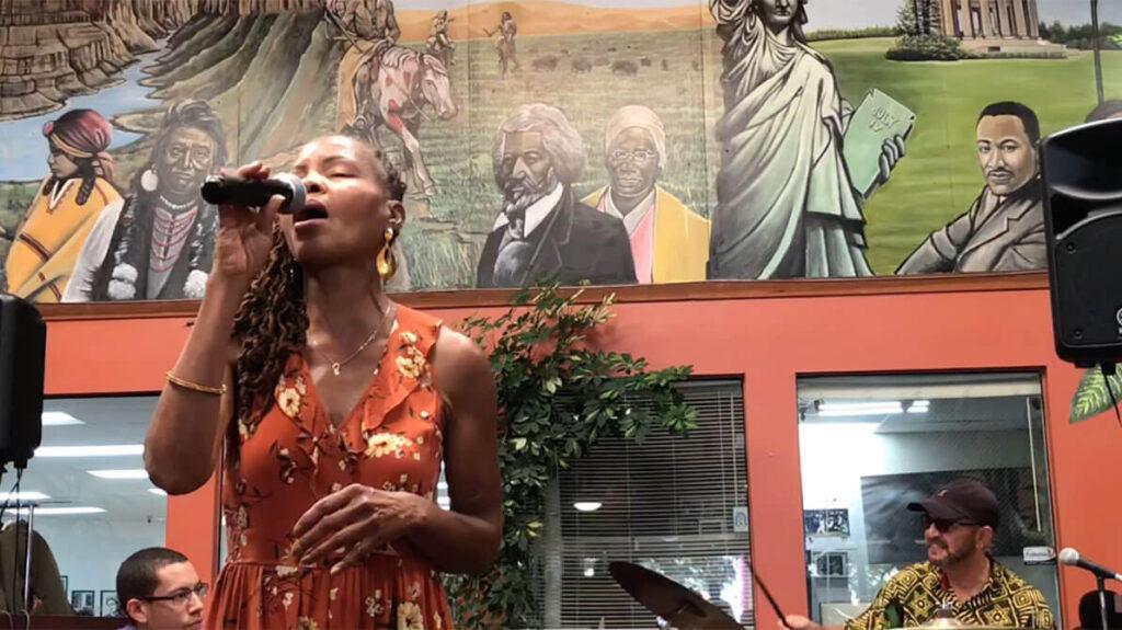 african marketplace 2019 - sabrina singing closeup 1