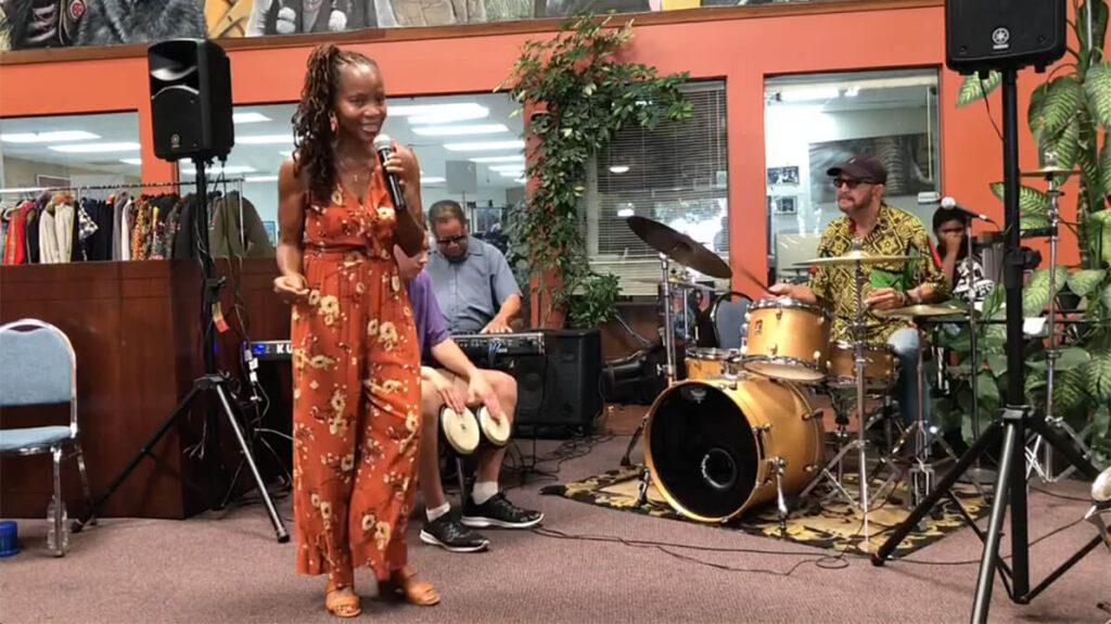 african marketplace 2019 - full shot of sabrina singing 6