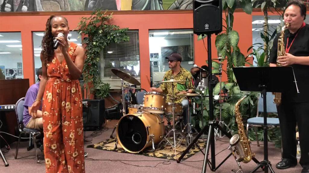 african marketplace 2019 - full shot of sabrina singing 5