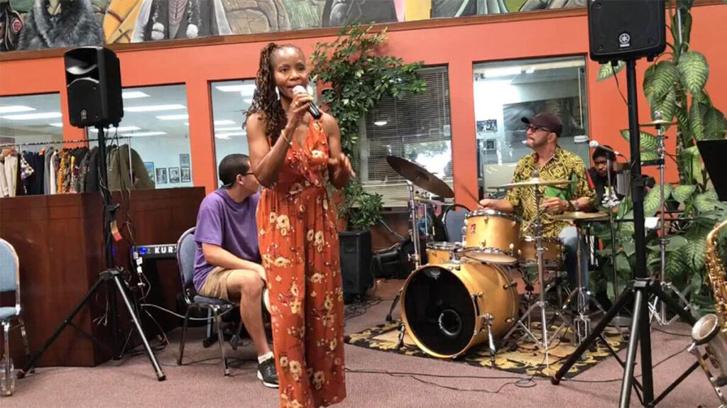 african marketplace 2019 - full shot of sabrina singing 3