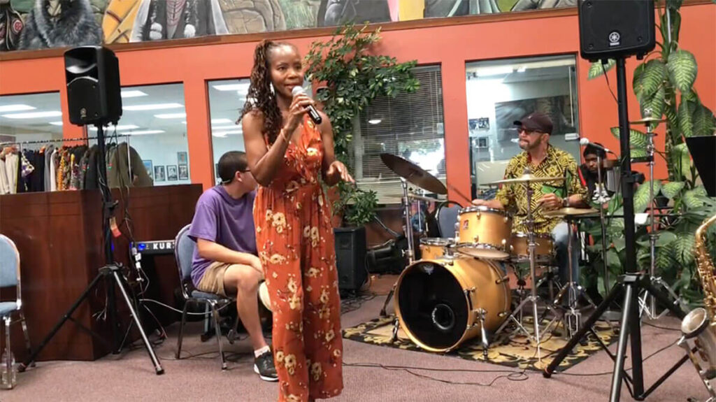 african marketplace 2019 - full shot of sabrina singing 2