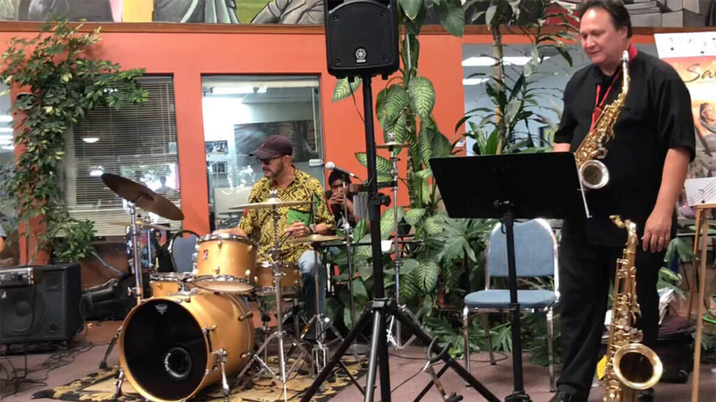 african marketplace 2019 - wide shot of drums and sax player